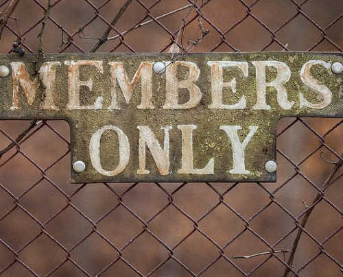 Members only sign on fence