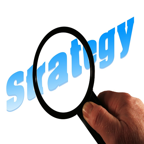 "Magnifying glass moving over the word ""strategy"""