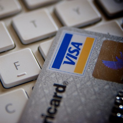 Photo of credit card laying on a keyboard