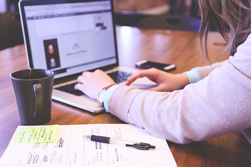 managing brand reputation online, woman working at computer