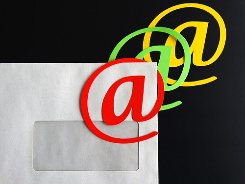 email marketing, letter with email sybmol in postage location, challenges with email marketing